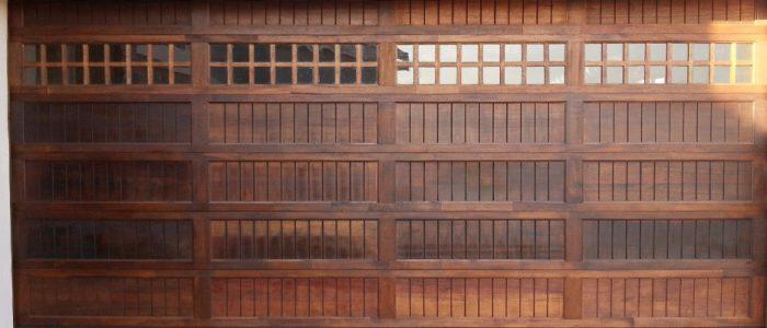 Cape Cottage With Windows Wooden Garage Door